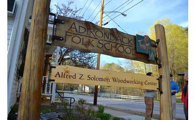 a sign outside the adirondack folk school