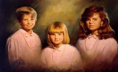 a portrait of three young women all wearing the same pink shirt