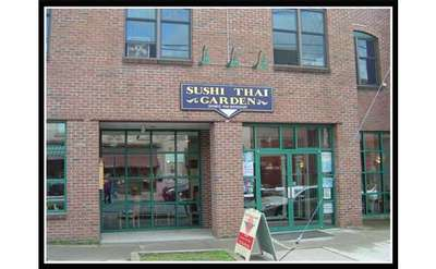 exterior of sushi thai garden, a brick building with large windows