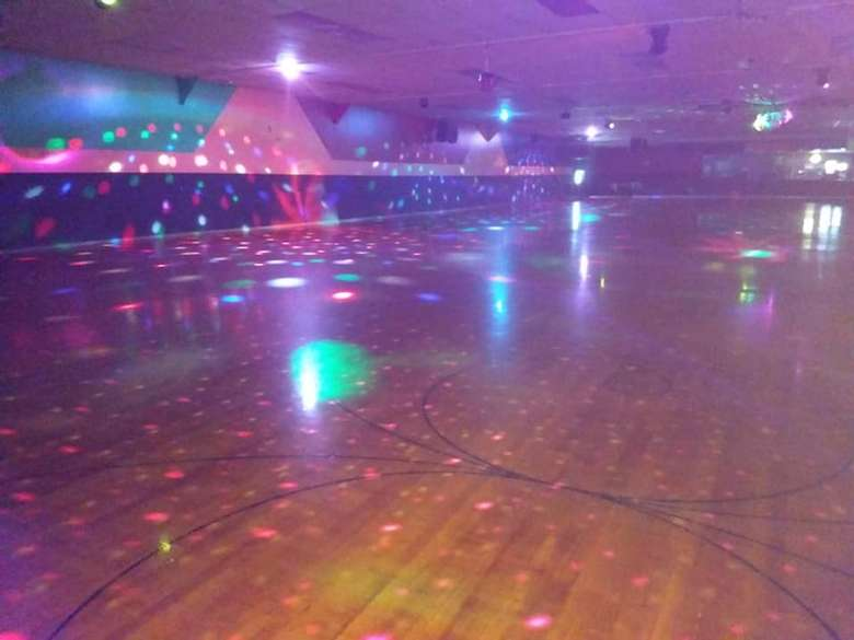 Rollarama Skating Center Empty Floor with Disco Ball and Lights Going