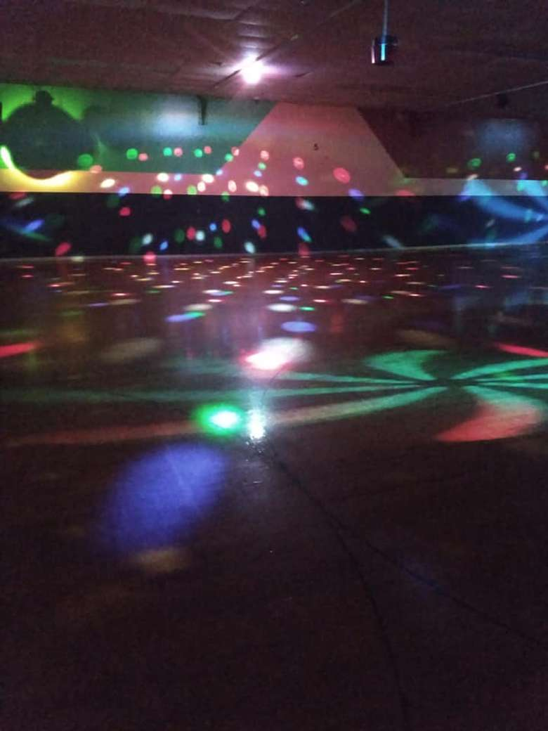 Rollarama Skating Center Empty Wall with Disco Ball and Lights Going
