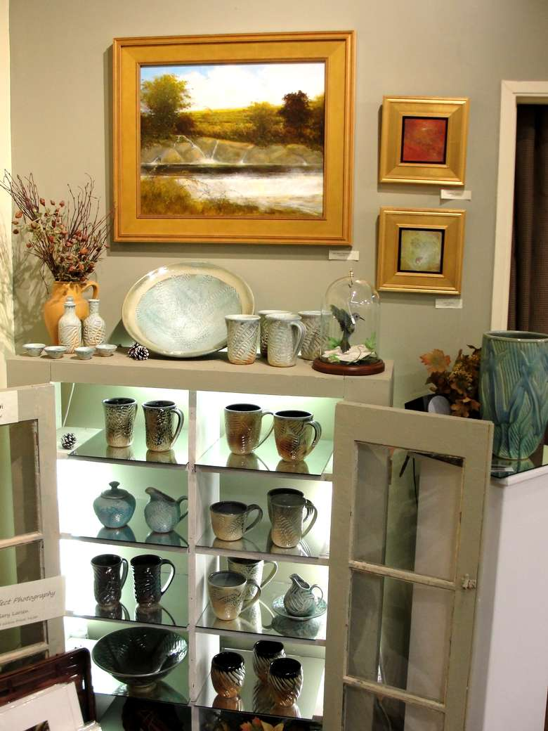 Pottery  mugs and containers in shelving