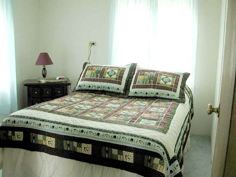 double bed with quilted bedspread
