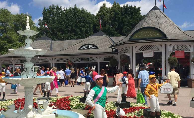 saratoga race course entrance with jockey statues