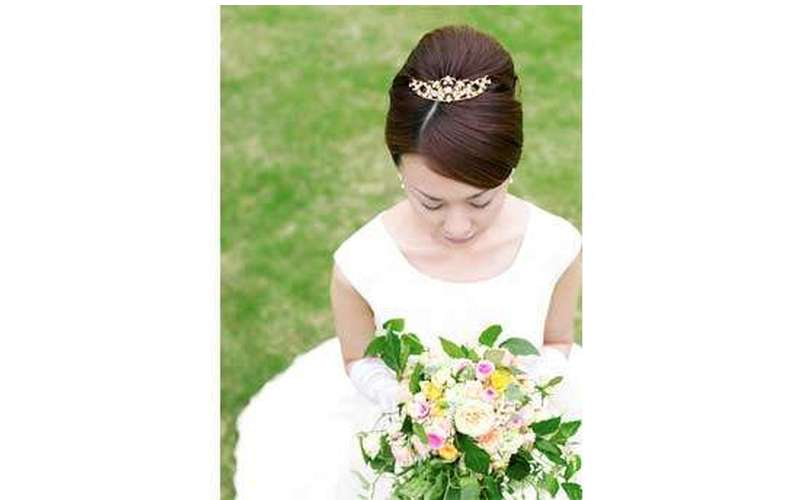 Photo from above of a bride's updo with a small tiara