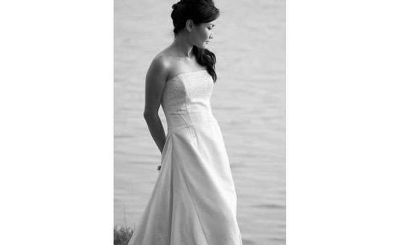 black and white photo of a bride in a slim gown