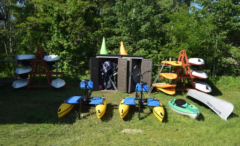 kayaks and stand-up paddleboards on racks ready to be rented