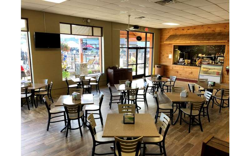 The Beach Cafe offers grab and go breakfast items and lunch and dinner menu including hamburgers, chicken sandwiches, salads, snacks and of course beverages