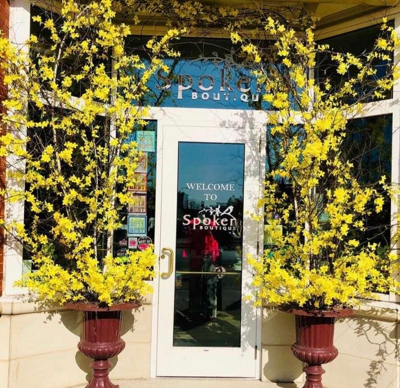 Spoken Boutique door with yellow flower arch
