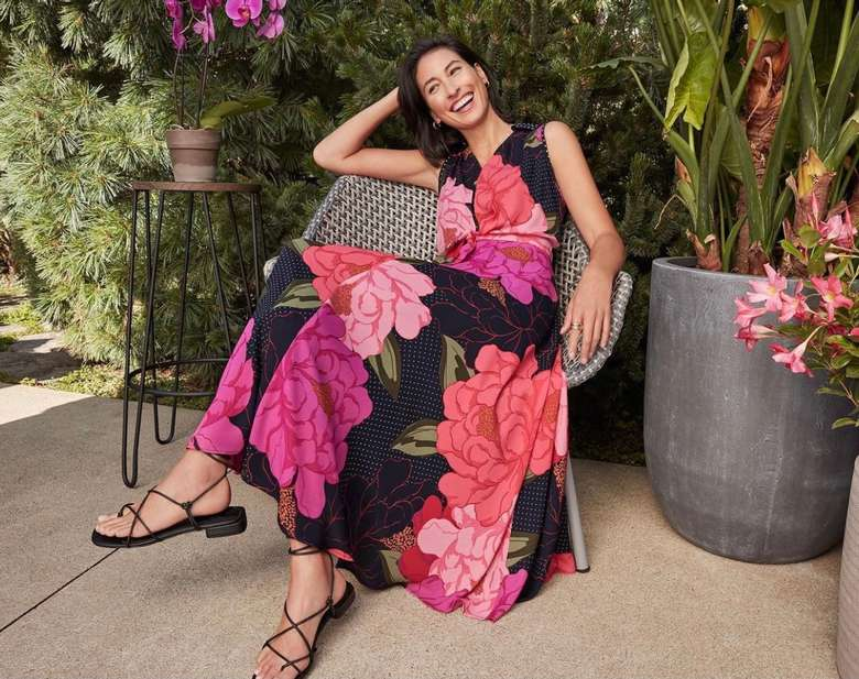 woman in a floral print dress lounging on a chair