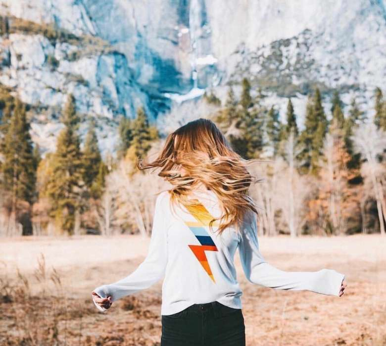 woman In white sweater with a lightning bolt on it