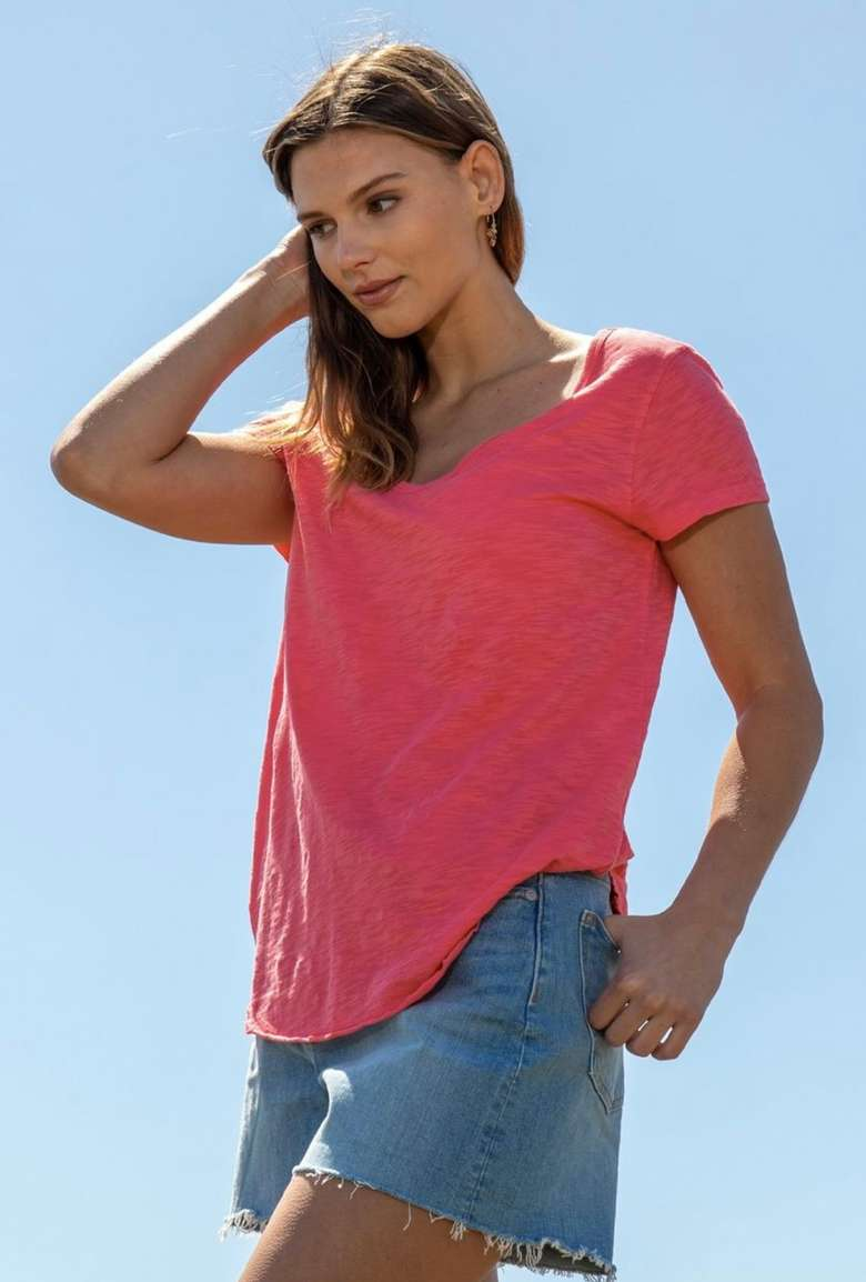 woman with pink shirt and shorts