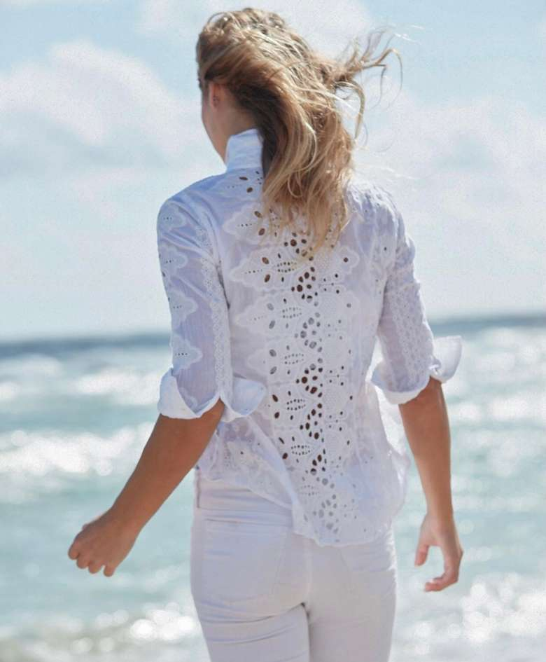 woman in white eyelet top