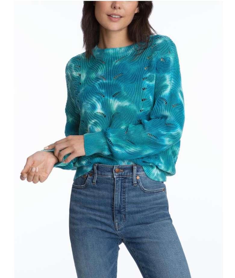 woman in tie dye blue sweater