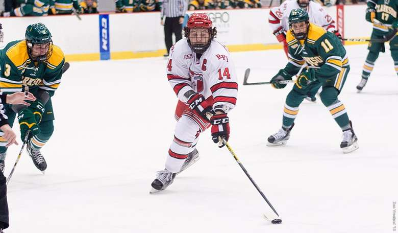 Mens Hockey player from RPI surrounded by opposing team