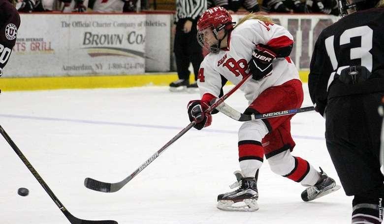 Rpi Womens hockey player charging at puck