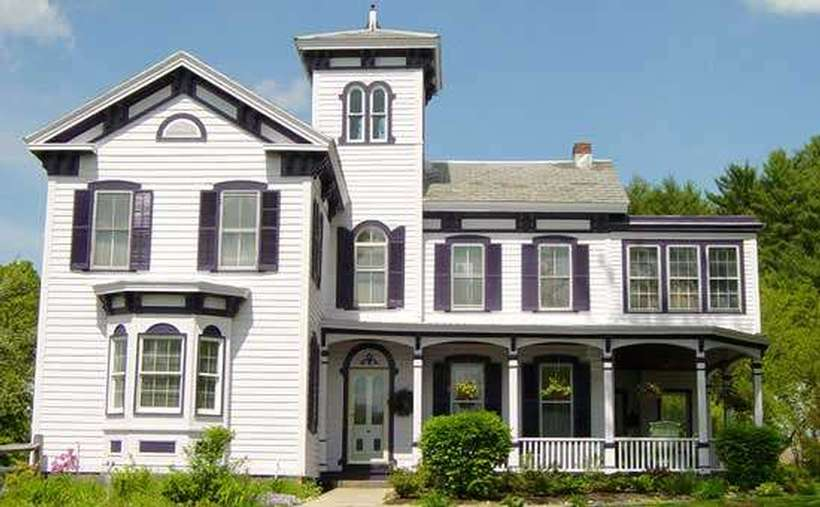 outside of bed and breakfast, white with purple shutters