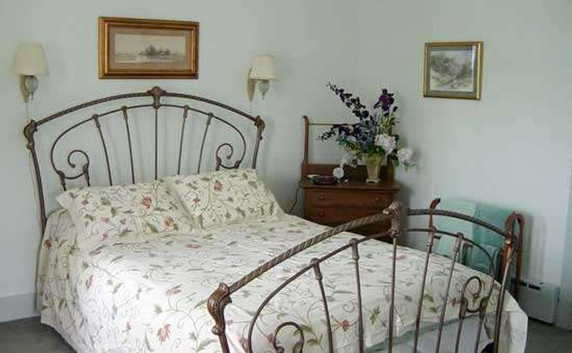 bed with floral pattern in bedroom