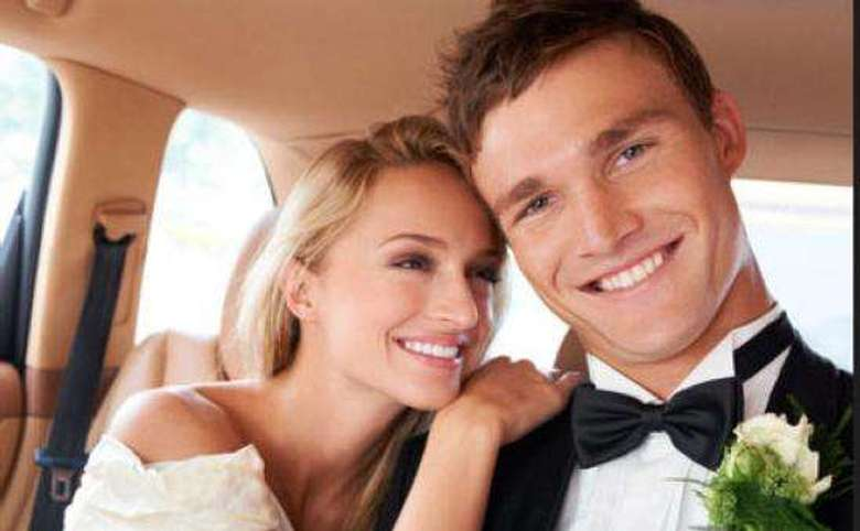 bride and groom in the back seat of a car