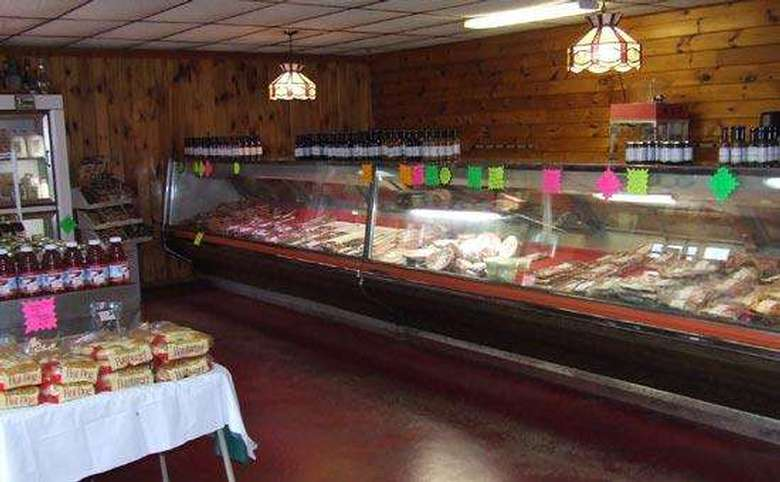 large display case with fresh meats