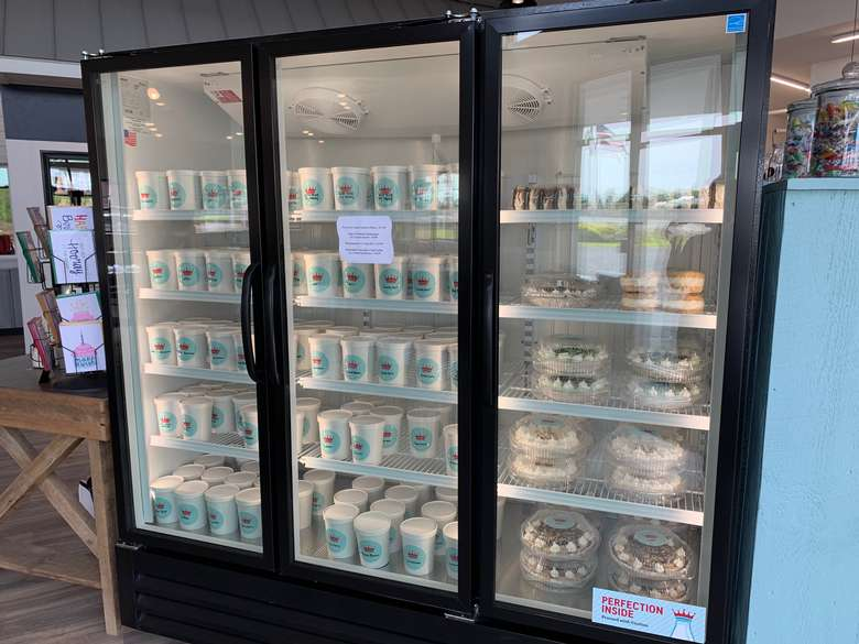 refrigerators full of yogurt or ice cream and other desserts