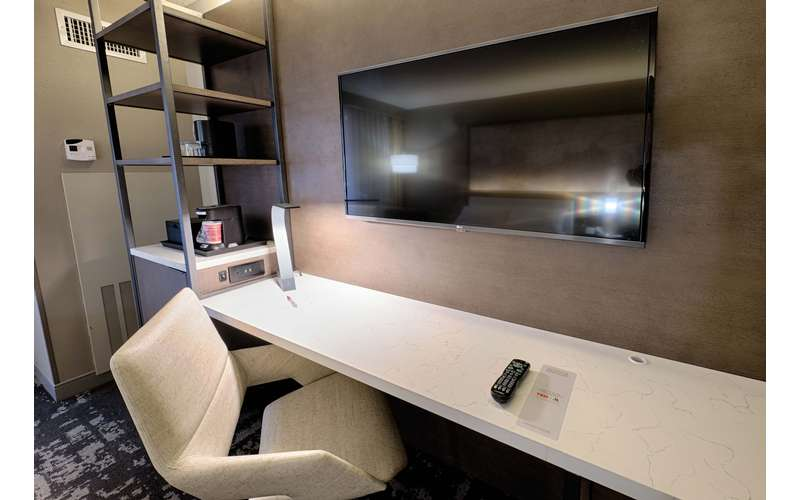 Need to get some work done? Have a seat at your room's spacious desk.