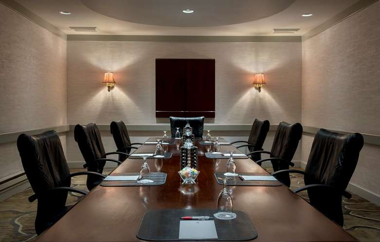 a small meeting room with a table and chairs