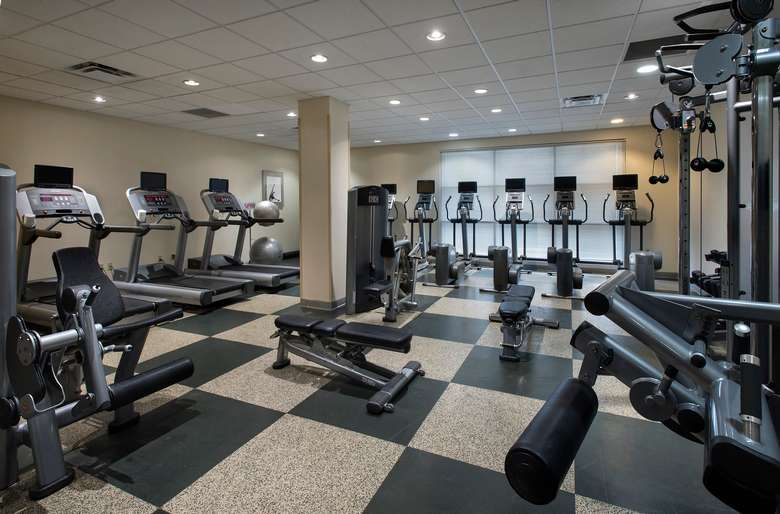 a fitness center filled with machines