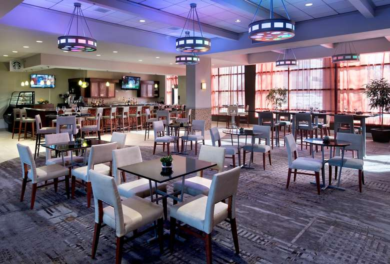 a lounge and bar area inside a hotel