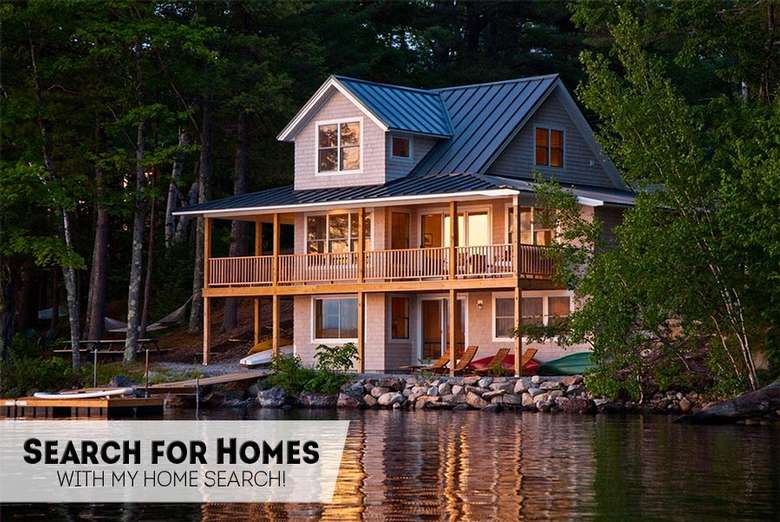 a three story house by the water