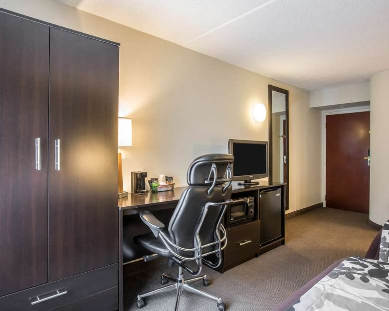 storage, desk, and television in a hotel room
