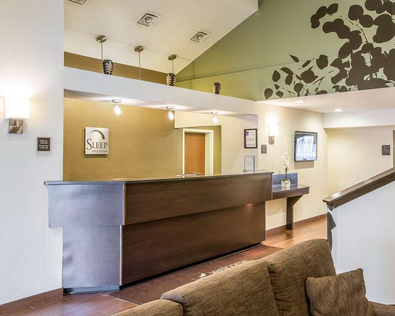 front desk of the sleep inn and suites