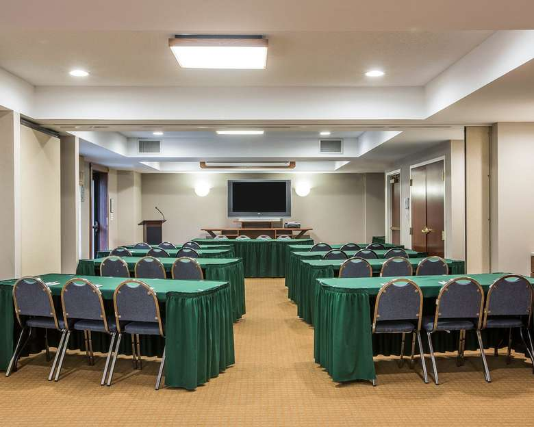 hotel conference room set up for a presentation with tables and chairs