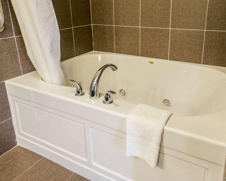 tub in a hotel bathroom