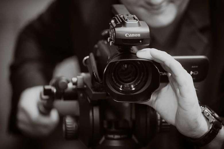 a person using a canon camera