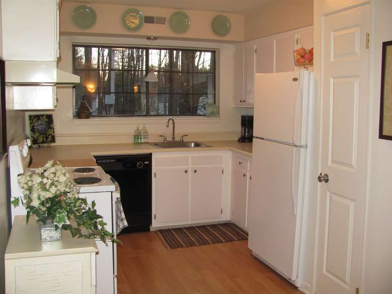 kitchen area with dishwasher, oven, stove, sink and fridge in view