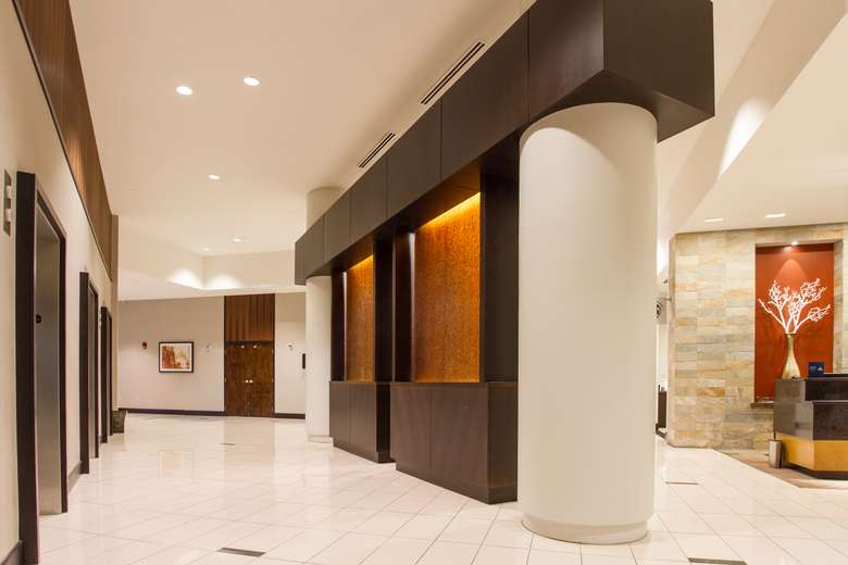 modern hotel lobby with three elevators