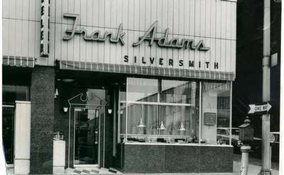 historic photo of the outside of frank adams jewelers