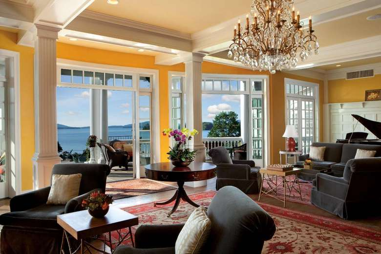 a large suite with views of the lake from a balcony