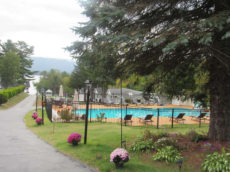 outdoor pool with lake george in the distance