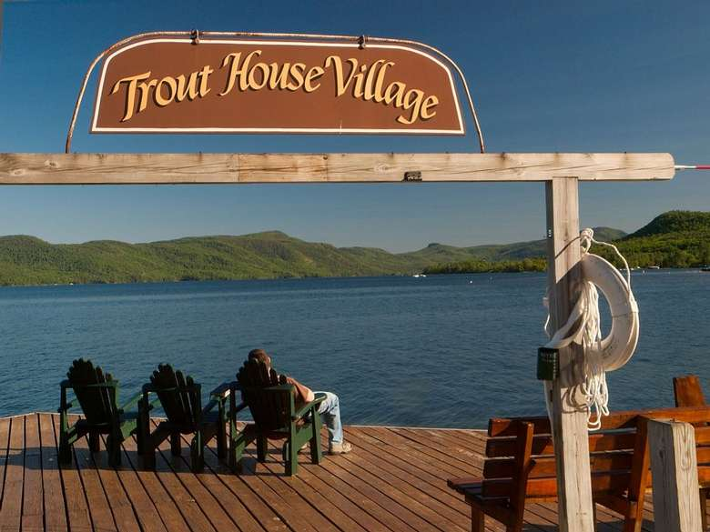 sign by dock that says Trout House Village
