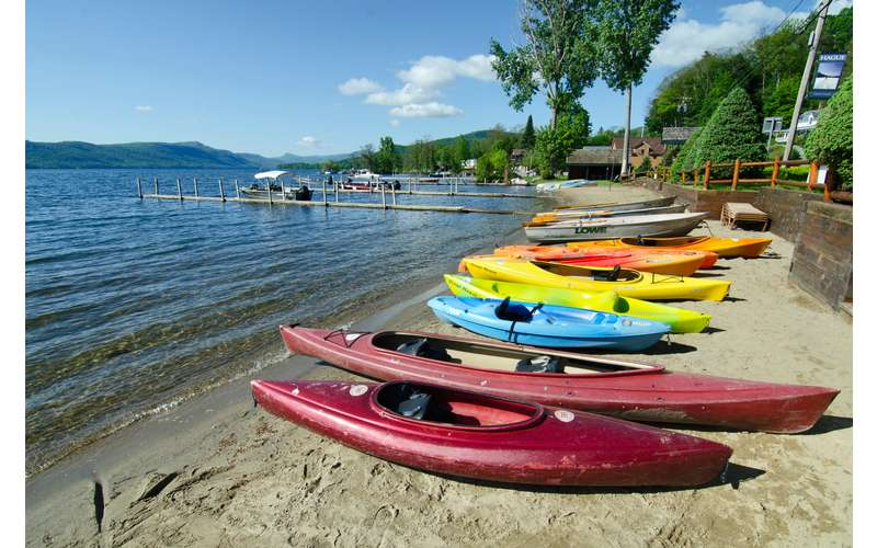 colorful kayaks lined up on a beach
