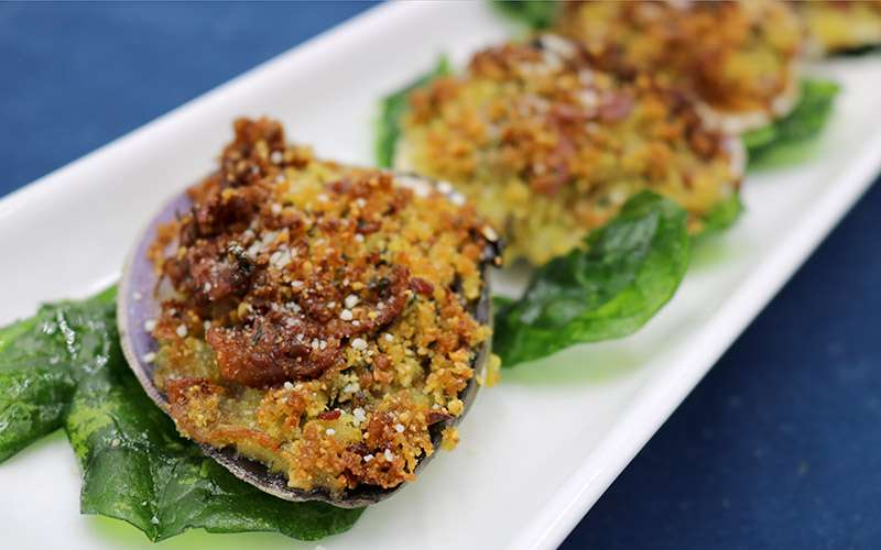 three stuffed clams on a plate