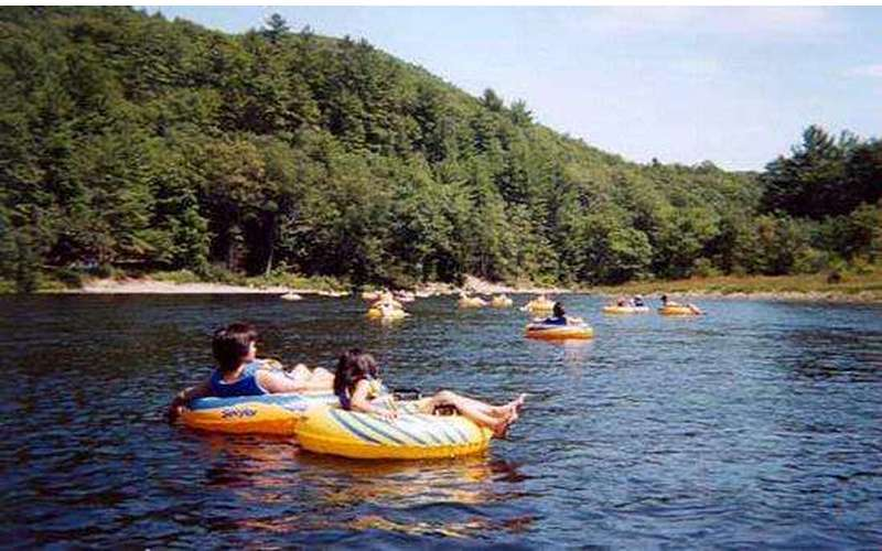 group of people lazy river tubing