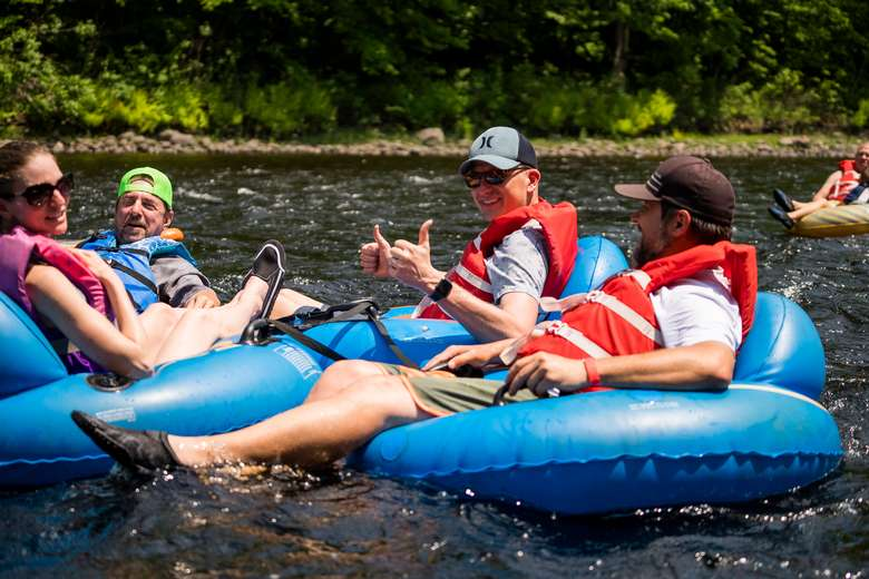 group of people river tubing