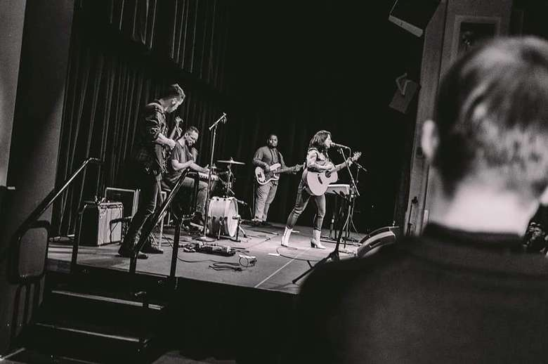 black and white photo of band playing