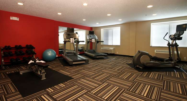 exercise room with weights and machines
