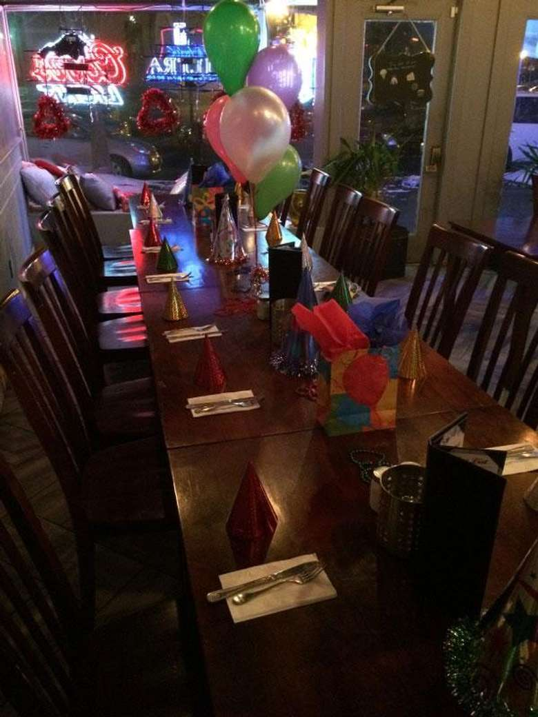 tables with birthday decorations and balloons