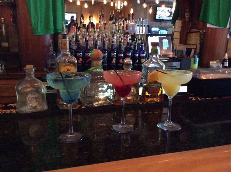 three cocktails on a bar