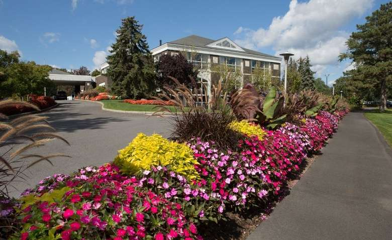 Wolferts Roost Clubhouse complimented by beautiful flowers